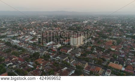 Cityscape Yogyakarta With Buildings, Highway At Sunset Time. Aerial View Cultural Capital Indonesia