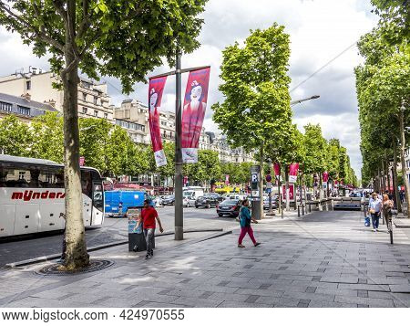 Paris, France - June 12, 2015: People Walking And Visiting The Famous Street In Paris, The Champs D´