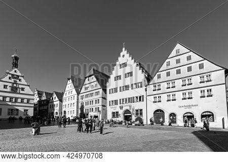 Rothenburg, Germany - April 19, 2015:  People At The Market Place Of Rothenburg Ob Der Tauber, Germa