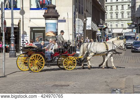 Vienna, Austria - April 25, 2015: People Enjoy Horse-drawn Carriage Or Fiaker, Popular Tourist Attra