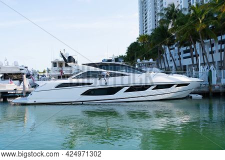Yacht Berth In Miami, Usa. Luxury Yachts Docked At Pier. Modern Sea Boats. Yachting And Boating