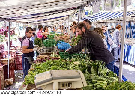 Paris, France - June 13, 2015: People Buy At Street Market In Chaillot, Paris, France. At The Farmer