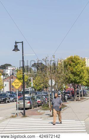 Portland, Usa - September 15, 2017: People Walk Along The Hancock Road In Portland With Skyline In B