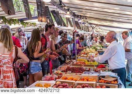 Paris, France - June 13, 2015: People Buy At Street Market In Chaillot, Paris, France. At This Farme