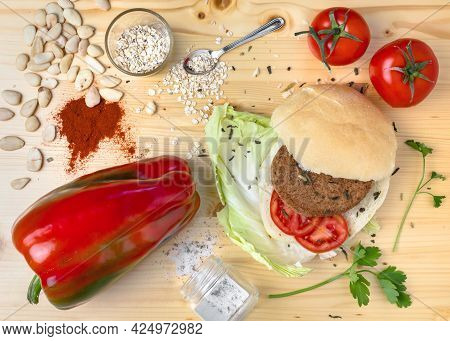 Veggie Burger. Homemade Veggie Burger With Ingredients, On A Light Wooden Background. Top View.