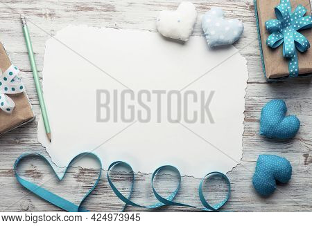 Flat Lay Composition With Fabric Love Hearts And Ribbon. Blank Sheet Of White Paper On Vintage Woode