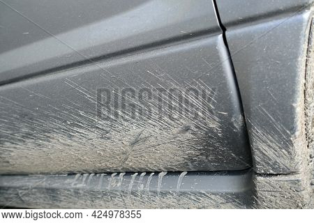 Detail of the car fender completely dirty by mud after a race on a muddy track