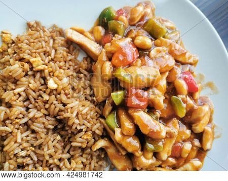 Kung Pao Chicken With Egg Fried Rice.  Traditional Chinese Food.