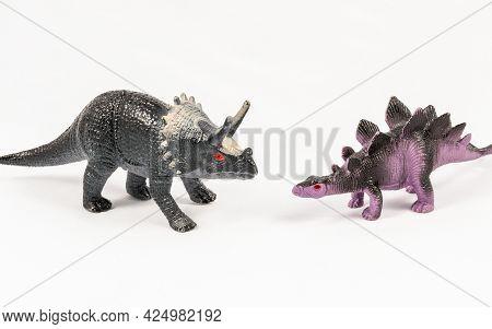 Stegosaurus And Triceratops Dinosaur Toy Models, Isolated On White Background