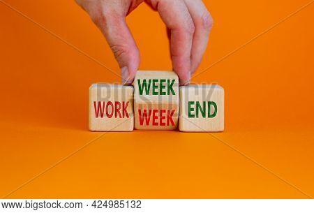 Work Week Or Weekend Symbol. Businessman Turns The Wooden Cube And Changes Words 'work Week' To 'wee