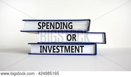 Spending Or Investment Strategy Symbol. Books With Words 'spending Or Investment'. Beautiful White B