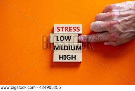 Low Or High Stress Level Symbol. Businessman Chooses The Wooden Block With Words Low Stress. Words S