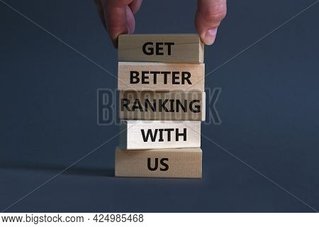 Get Better Ranking With Us Symbol. Wooden Blocks With Words 'get Better Ranking With Us'. Businessma