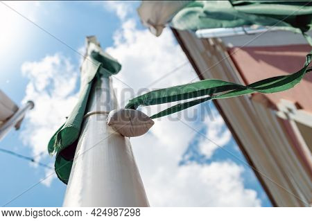 A Special Flag-tension Bag Hangs On A Flagpole With A Flag