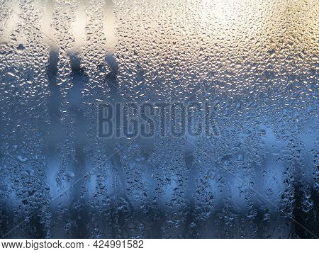 A Window Misted With Dew At Dawn. Close-up, Texture, Water Drops
