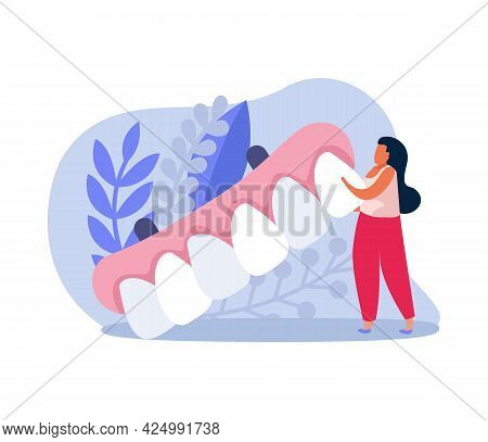 Dental Health Icon With Tiny Woman Holding Dental Prosthesis Vector Illustration
