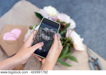 Woman Taking Mobile Photo Of Fresh Flowers, Florist Making Bouquet And Takes Pic With Phone For Soci
