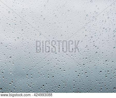 Rain Drops On Window Glass, Natural Pattern Of Raindrops. Natural Pattern Of Raindrops