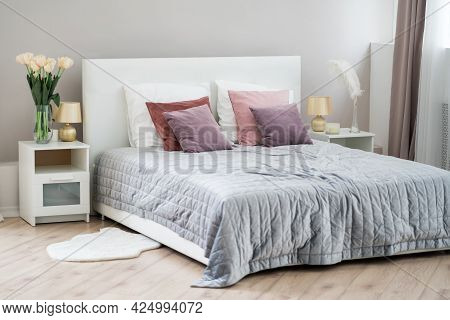 Beautiful Modern Bedroom, Interior Concept With Crumpled Bed Linen, Morning Mess At Home