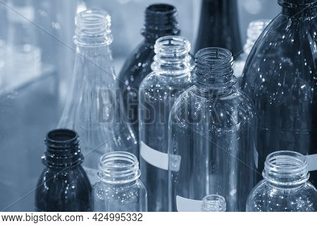 The Various Type Of Plastic Bottles With Lighting Effect. The Pet Bottle Container Manufacturing Pro