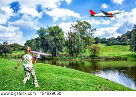A Girl Launching A Toy Aeroplane On Lawn With Airplane Taking Off.