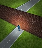 Business challenge and financial obstacles concept with a businessman standing in front of a large brick wall that has blocked his path and obstructed a journey to success poster