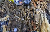 Voodoo objects for sale in a fetish market used for traditional medicine in West Africa poster