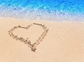 heart- a picture on sand . Close up in a sunny day poster