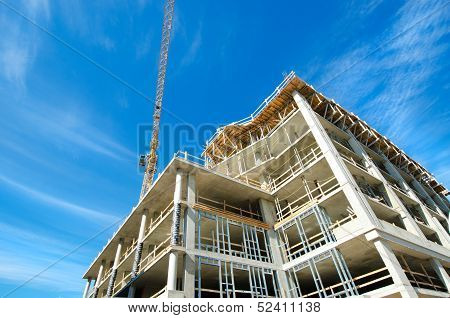 Concrete Highrise Construction site, with tower crane. poster