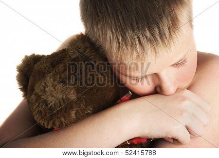 Sad big boy with his old friend teddy