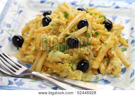 bacalhau a bras, Portuguese cuisine, a dish with salt cod, potatoes and eggs