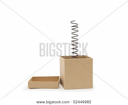 Surprise concept. Metal spring jumping from cardboard box. Clipping path is included poster