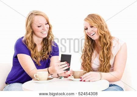 Happy Women Looking At A Smartphone