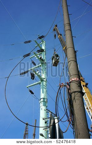 Electrician as spider between electric wire network