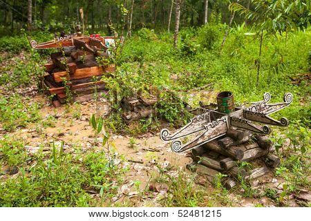 BERDUT, MALAYSIA - APR 8: Cemetery in village Orang Asli in his village on Apr 8, 2013 in Berdut, Malaysia. More than 76% of all Orang Asli live below the poverty line, life expectancy - 53 years old.