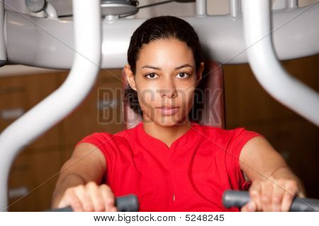 Beautiful Girl On Fitness Machine