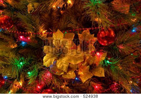 Christmas Tree With Golden Poinsettia Ornament