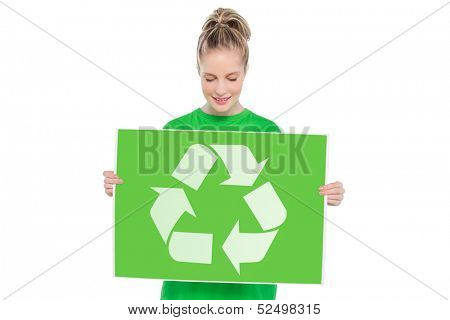 Content blonde environmental activist holding recycling sign on white background