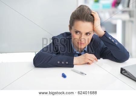 Stressed Business Woman Near Flipchart