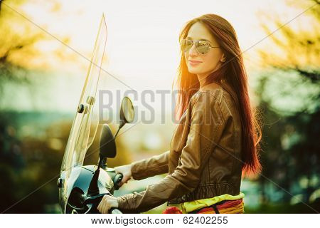 Young beautiful woman on motorcycle