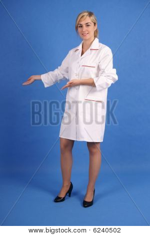 Smiling medical professional pointing right with both hands