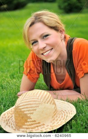 Young woman laying on the grass