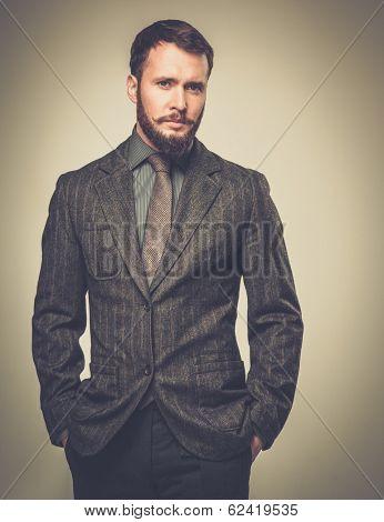 Handsome well-dressed man in jacket over his shoulder poster
