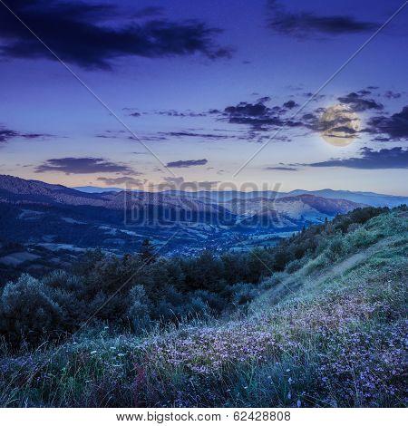 Village Between  Mountain At Night