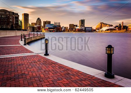 Long Exposure Of The Skyline And Waterfront Promenade In Baltimore, Maryland.