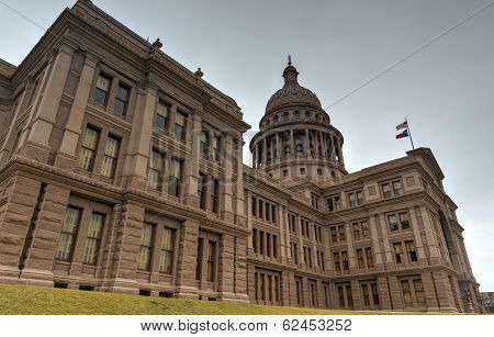 The Texas State Capitol Building in downtown Austin. The building was built in 1882-1888 of distinctive sunset red granite. poster