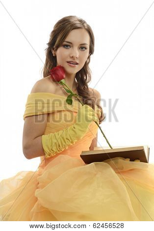 Young Woman wearing a princess costume holding a book and rose