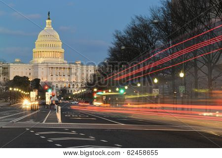 The U.S. Capitol building night view from from Pennsylvania Avenue with car lights trails - Washington DC, United States