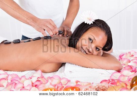 Placing Lastone On Woman Back