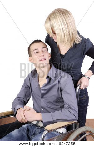 Young woman taking care of man in wheelchair